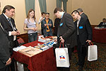 Participants looking through publications of the Chamber of Commerce and Industry